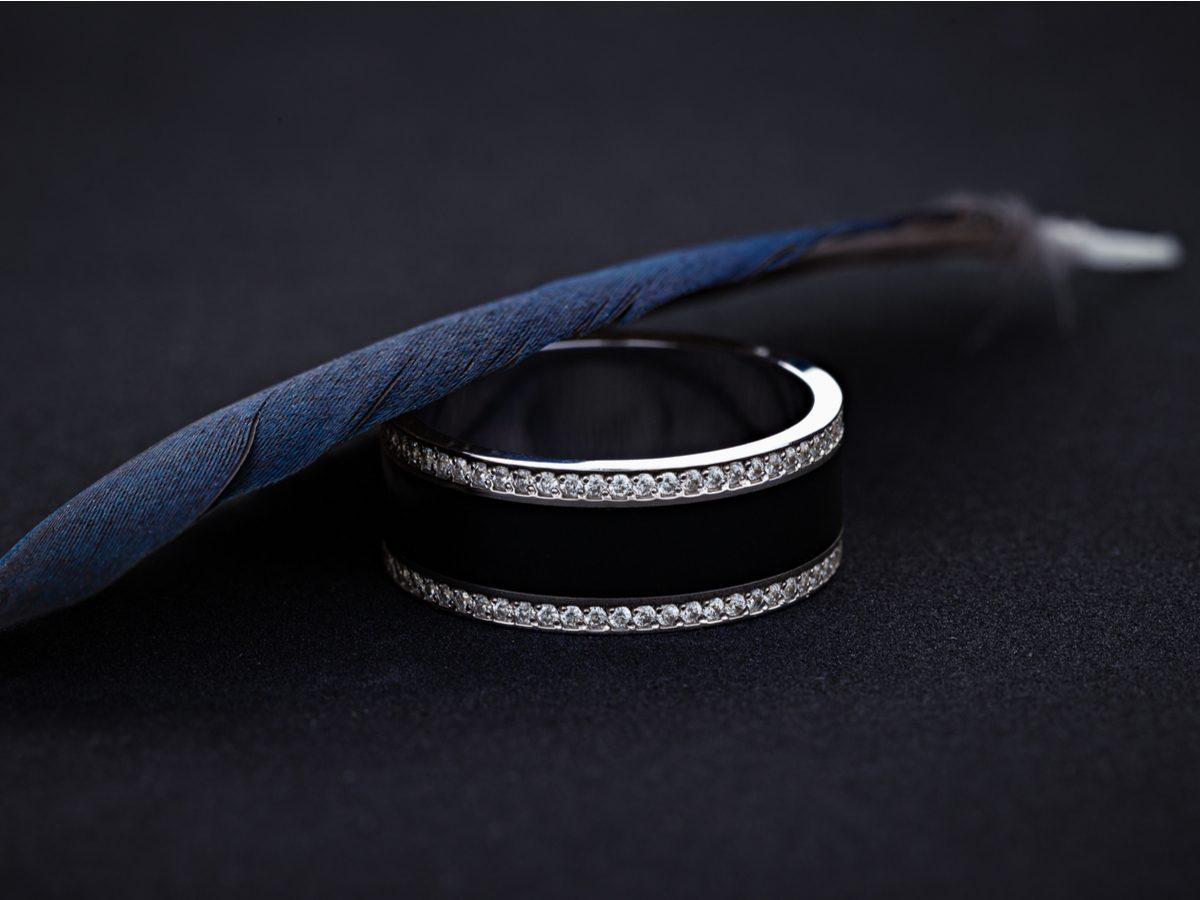 Wedding ring against black background