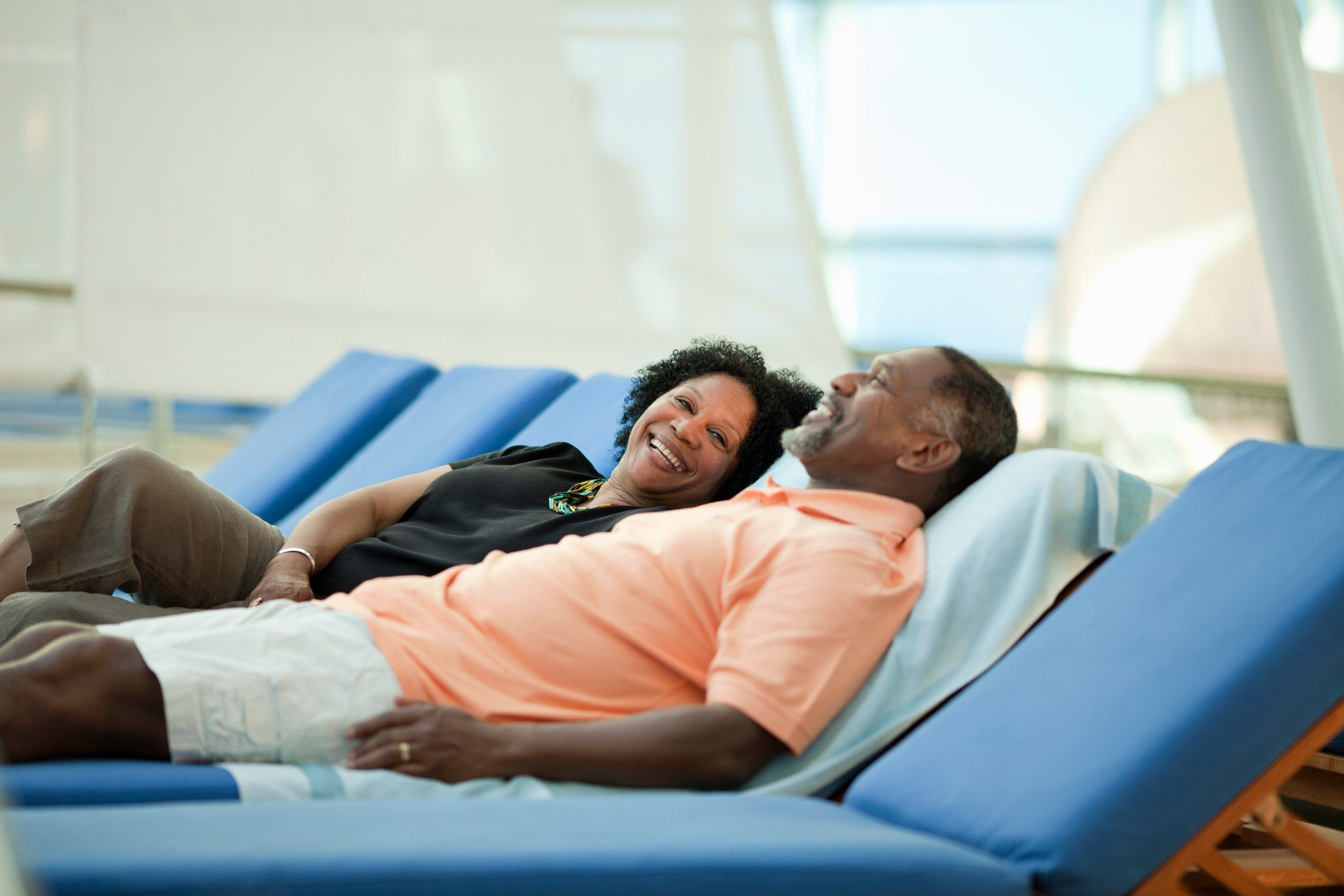 Mature couple on lounge chair on cruise ship