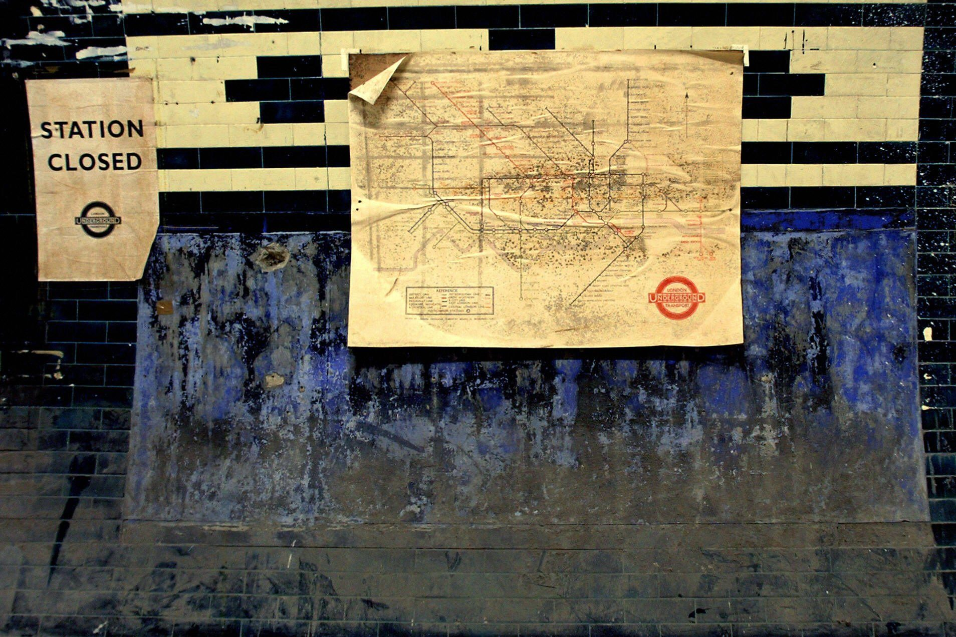 "An old subway map and ""station closed"" s"