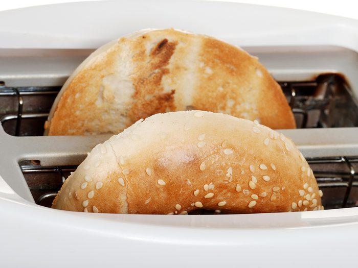 Bagel in toaster slices facing inward