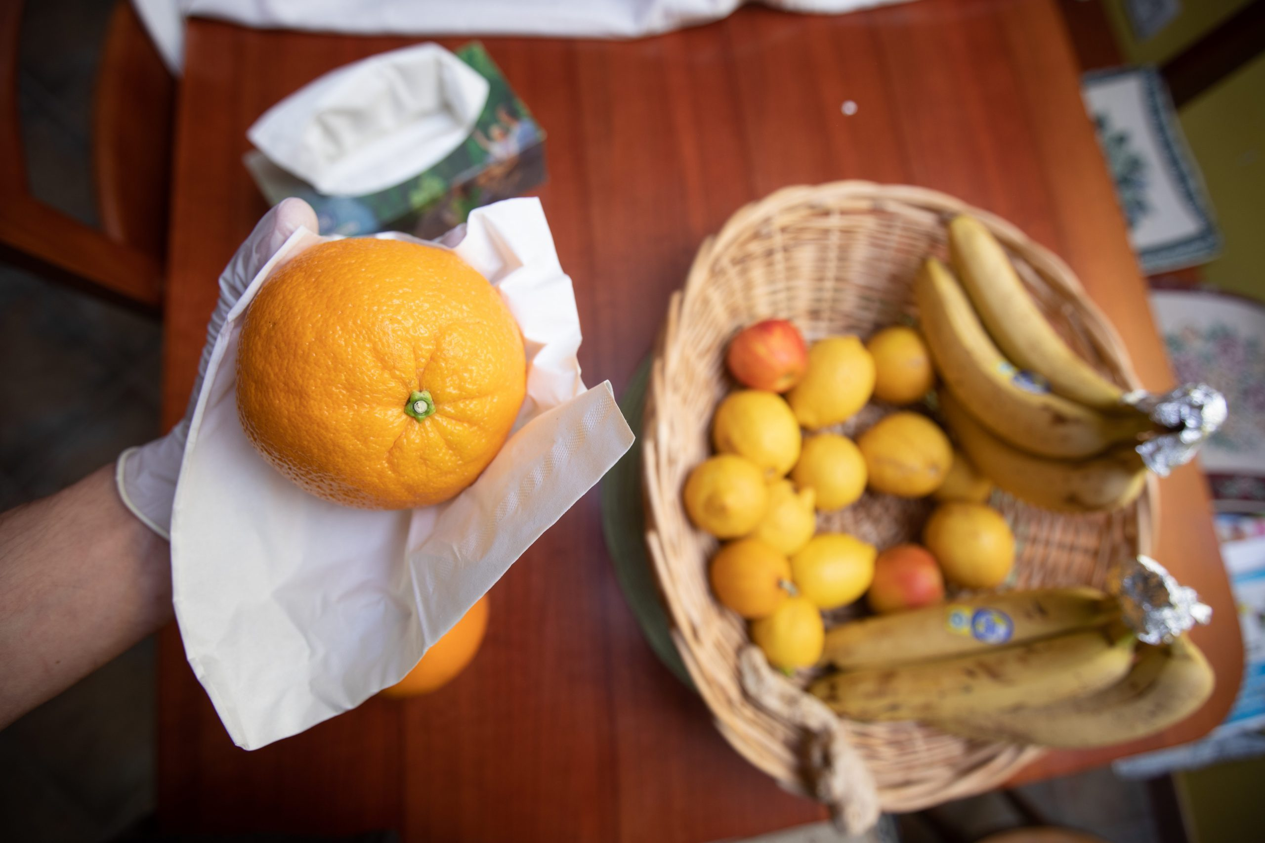 Close-up of Man Disinfecting Groceries at Home During Coronavirus Pandemic - Stock Photo