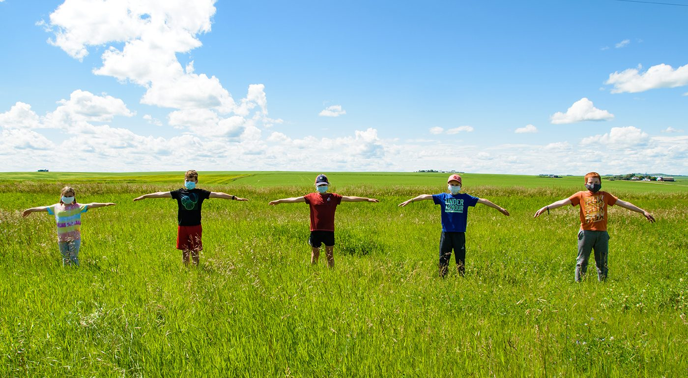 Face mask selfies from across Canada - kids standing in field