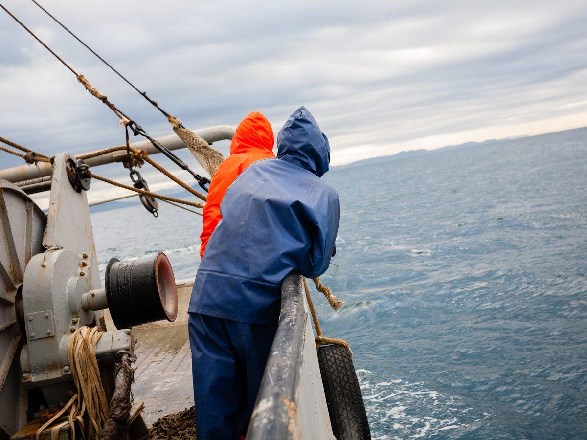 Two fishermen on a fishing trawler