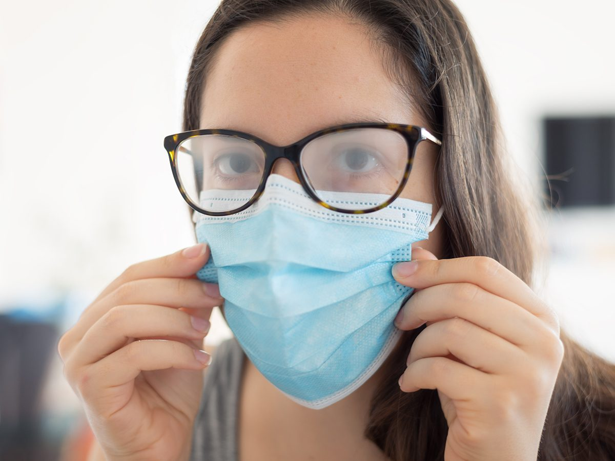 Glasses fogging up - woman wearing face mask with foggy glasses