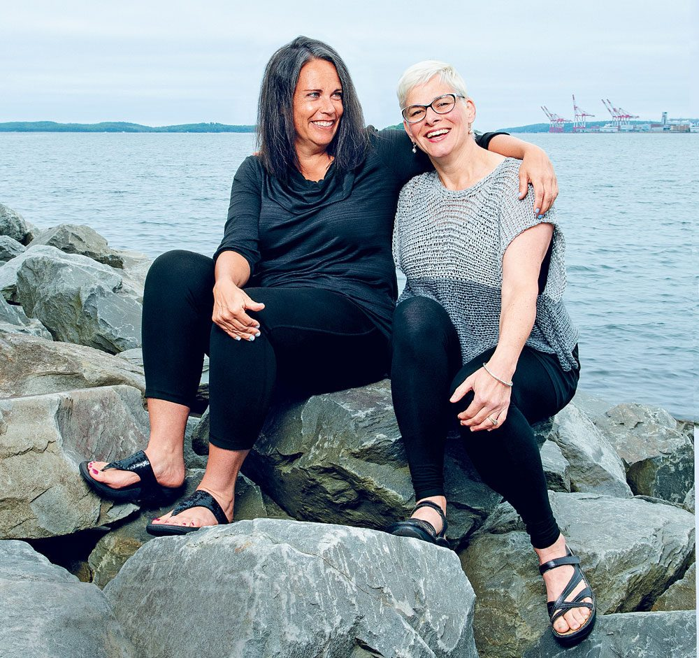 Life Lesson - friends Susan Goupil and Anne-Marie McElrone sit on a rock.