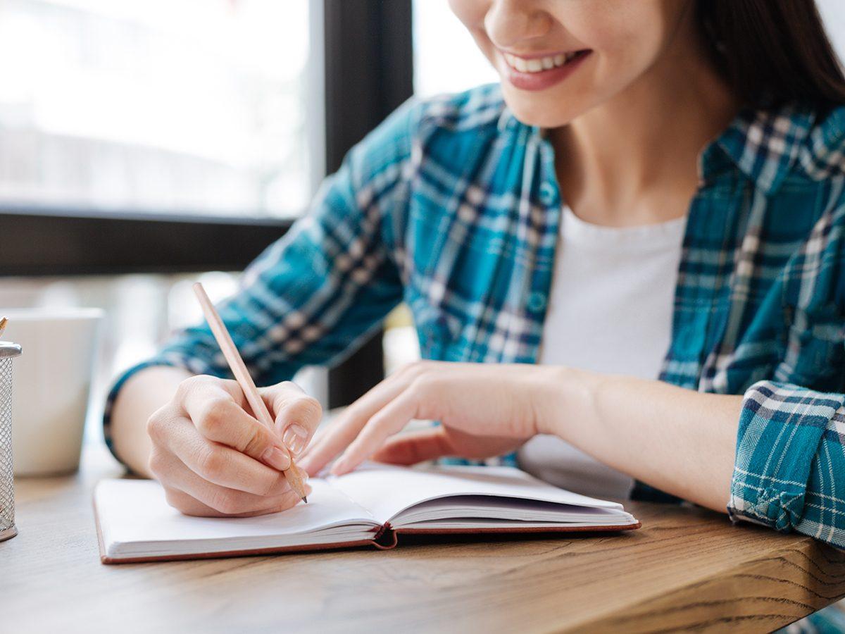 Morning brain exercises - woman writing list