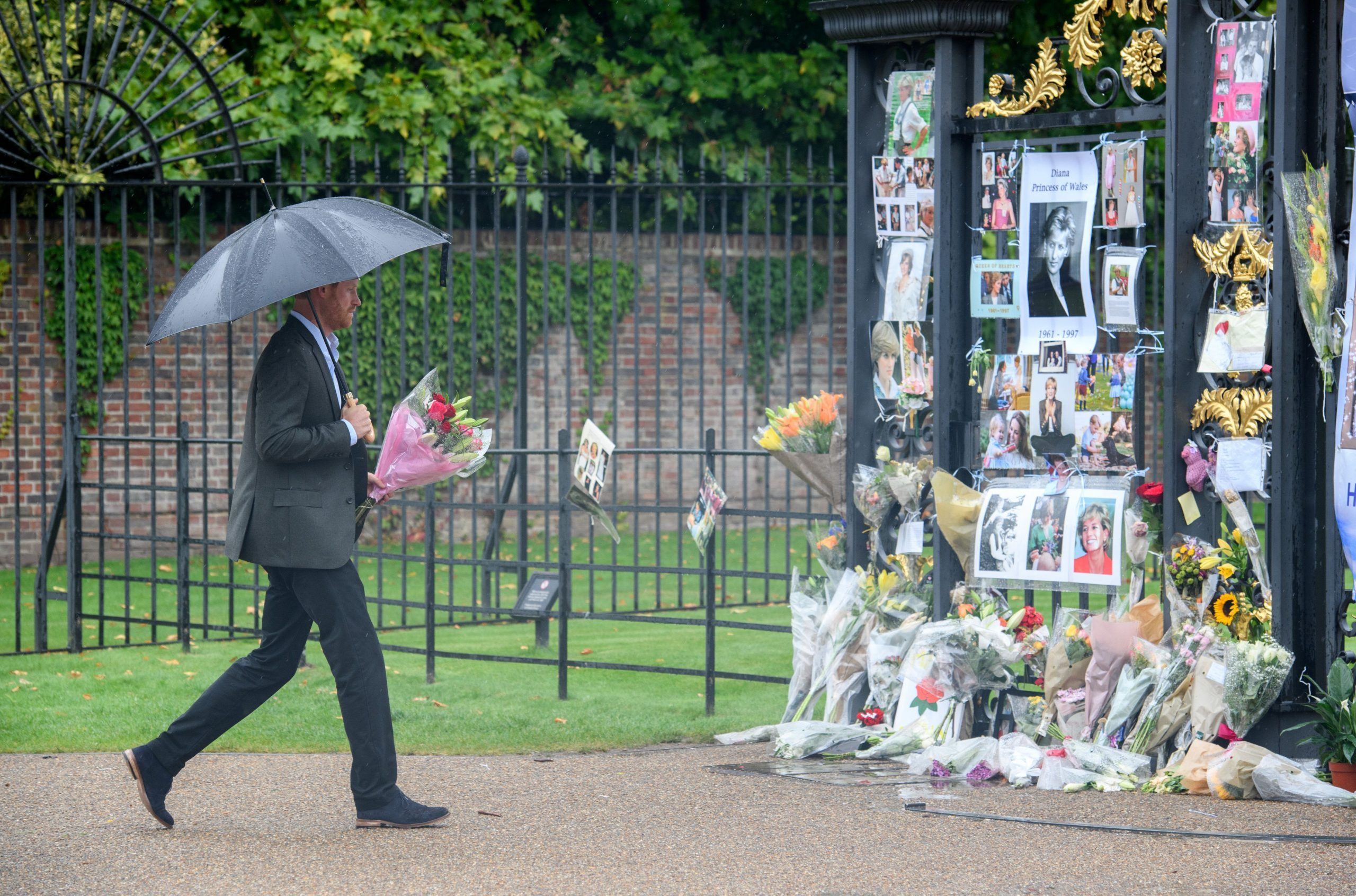 Prince William and Prince Harry leave tribute to Princess Diana at the gates of Kensington Palace, London, UK - 30 Aug 2017