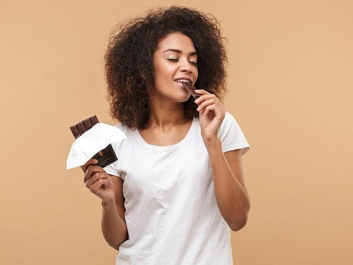 Secrets to a good night's sleep - woman eating chocolate
