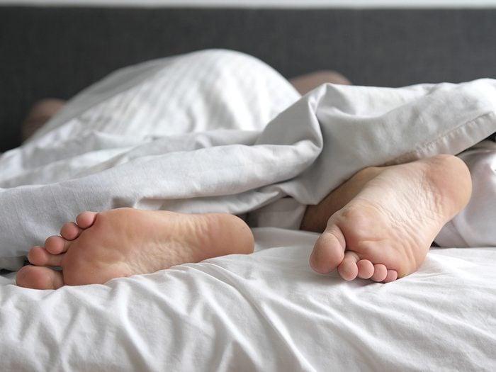 Secrets to a good night's sleep - feet in bed