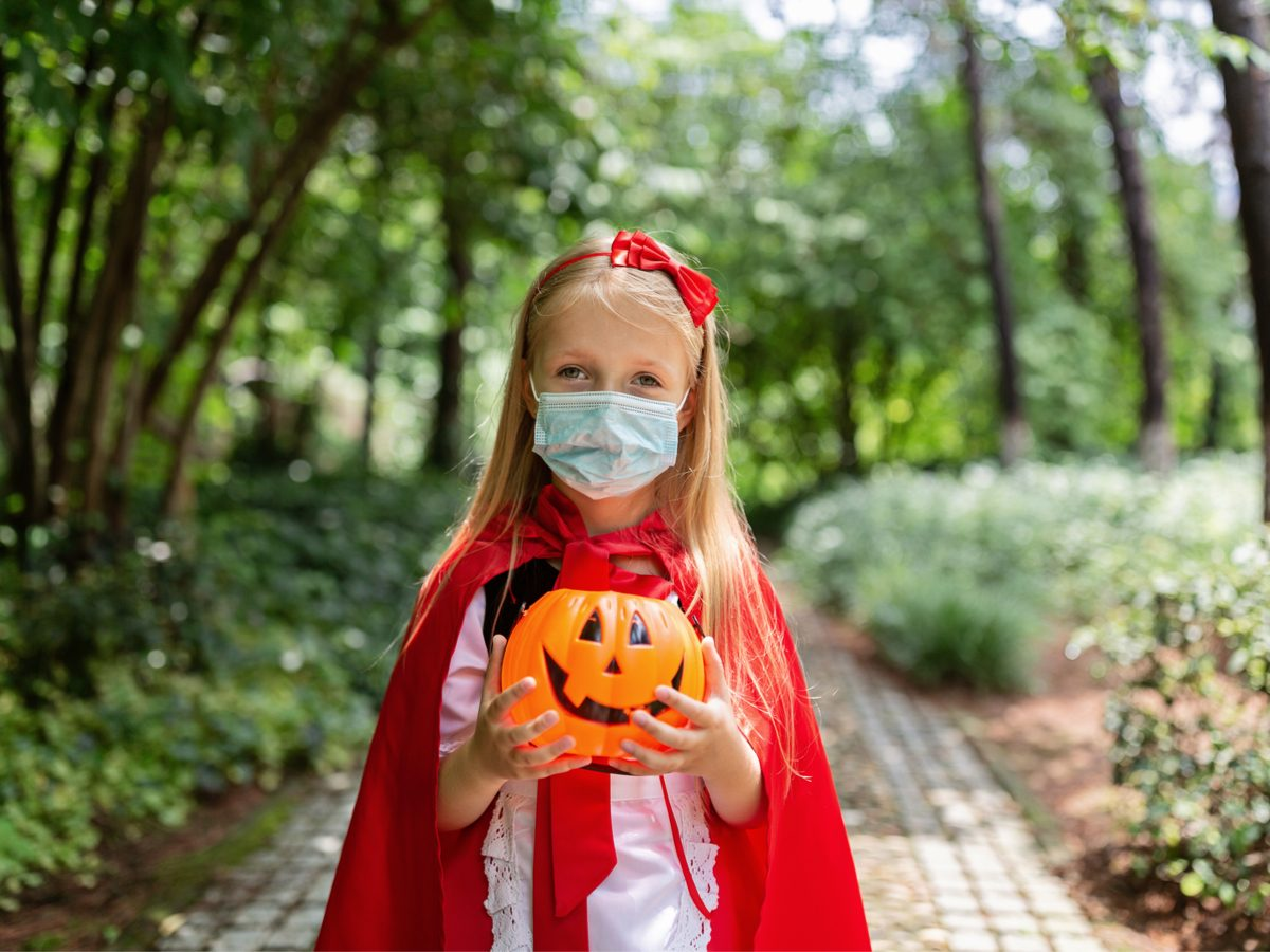 Is it safe to go trick-or-treating during COVID-19 pandemic - little girl in Halloween costume
