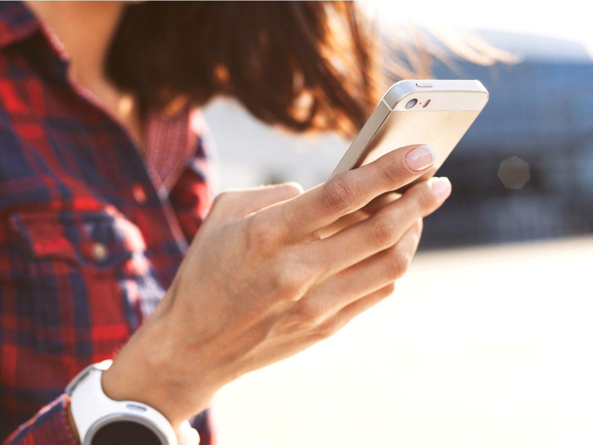 Woman writing on smartphone
