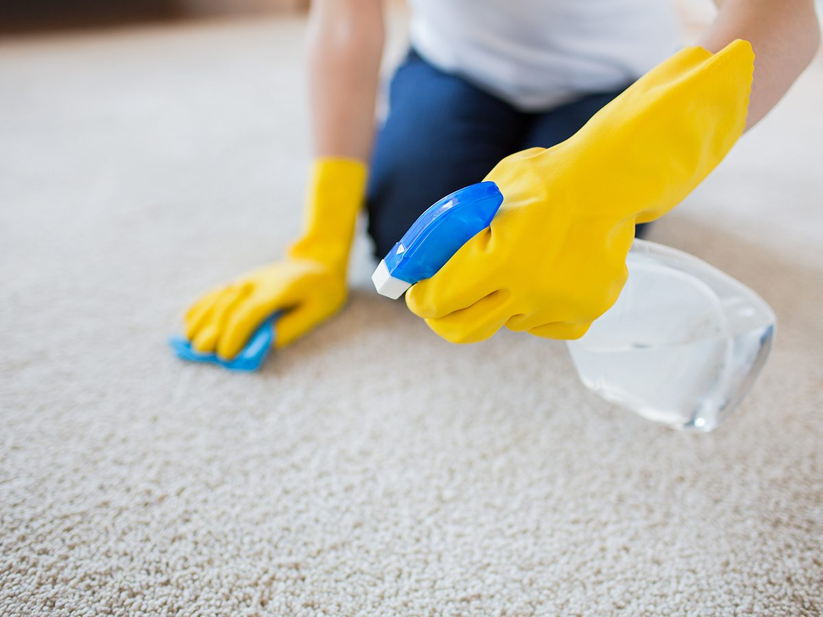 Bad cleaning habits - person cleaning carpet