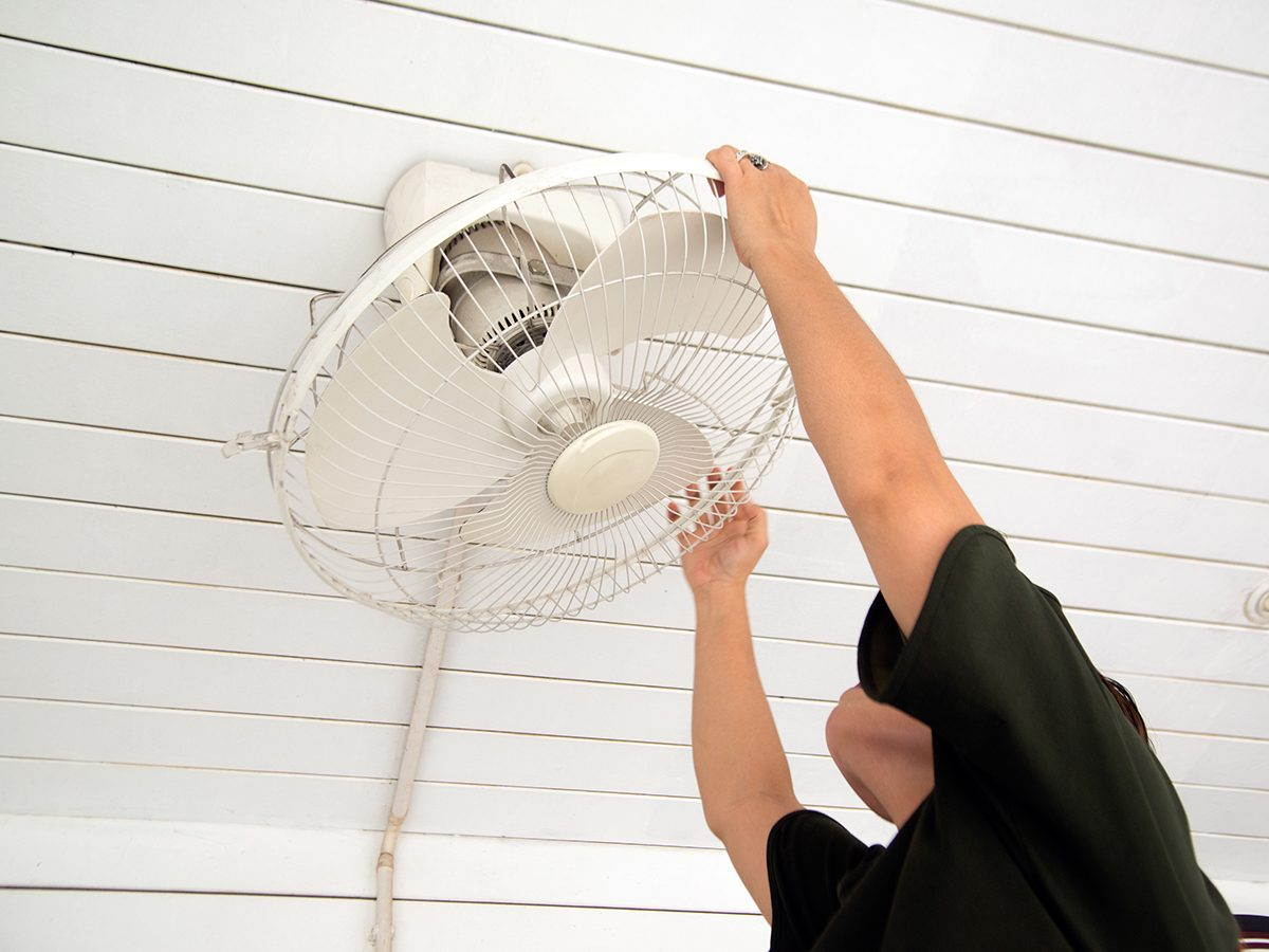 Bad cleaning habits - person installing ceiling fan