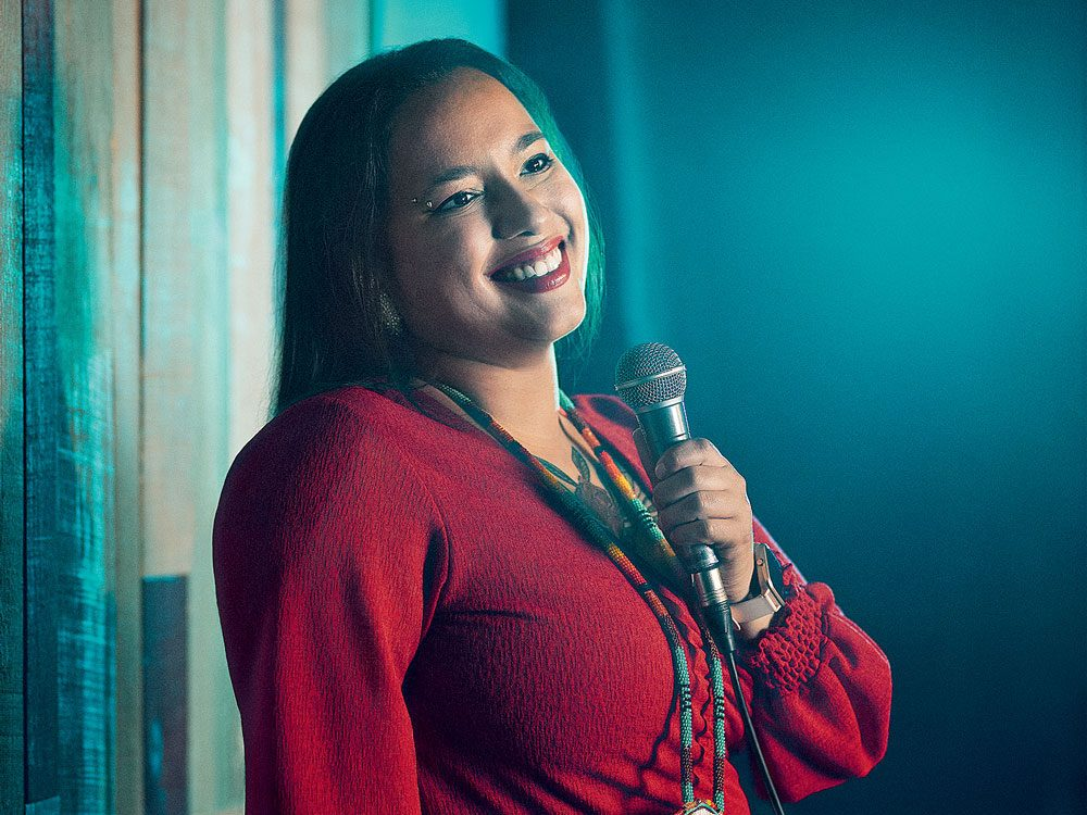 Comedian Janelle Niles on stage at Indigenous comedy show Got Land?
