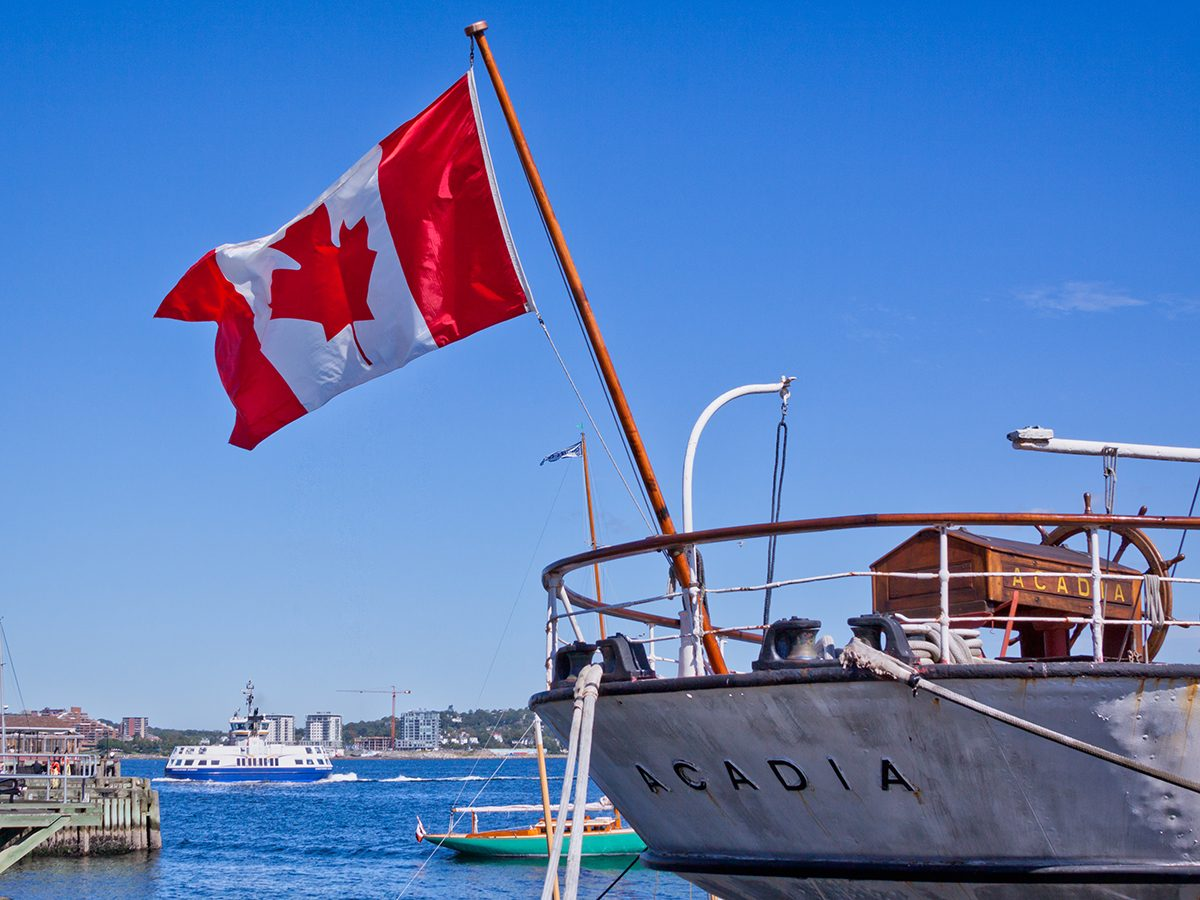 Best boat photography across Canada - boat in Halifax Harbour with Canadian flag