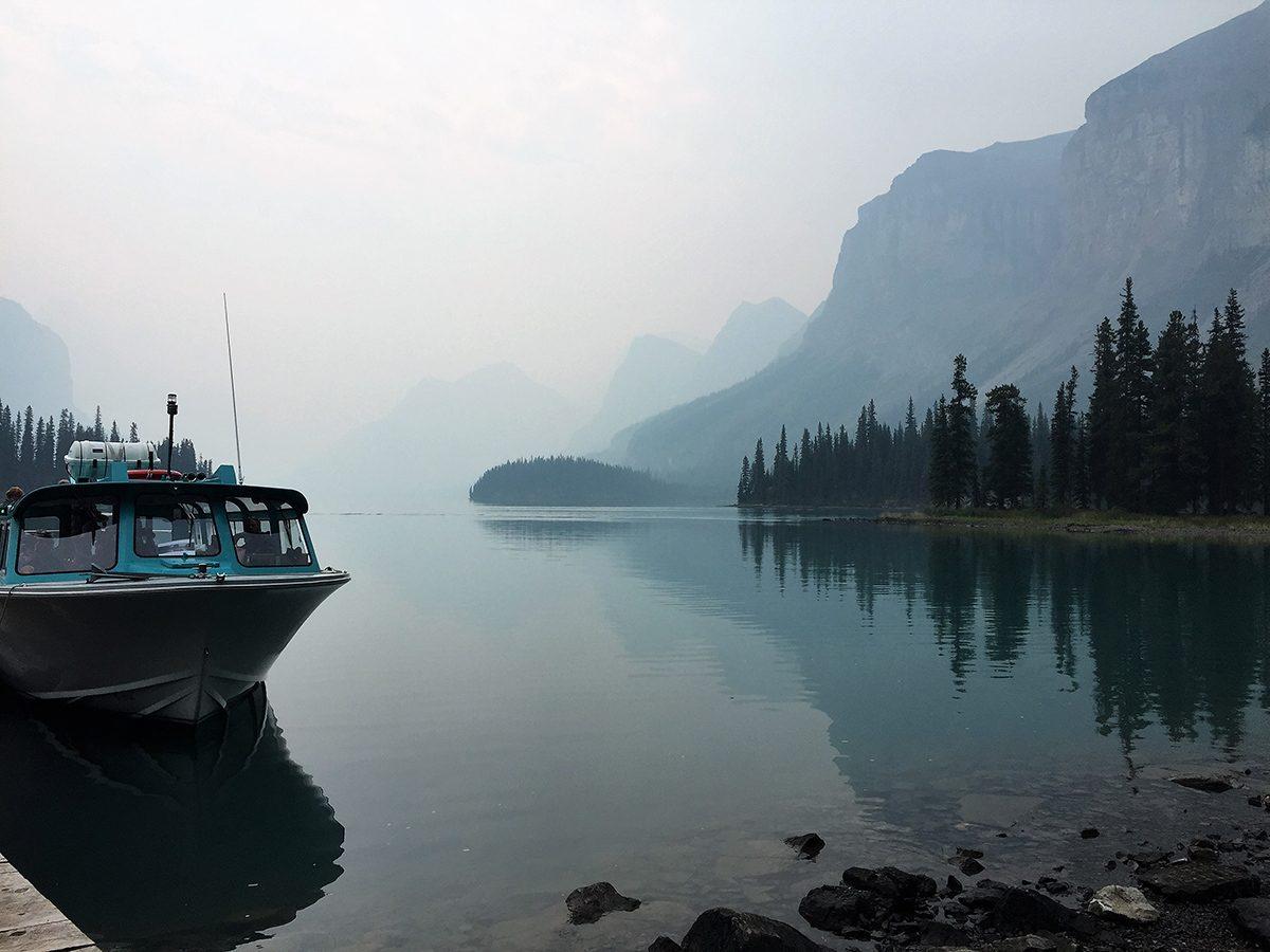 Best boat photography across Canada - Boat in Maligne Lake
