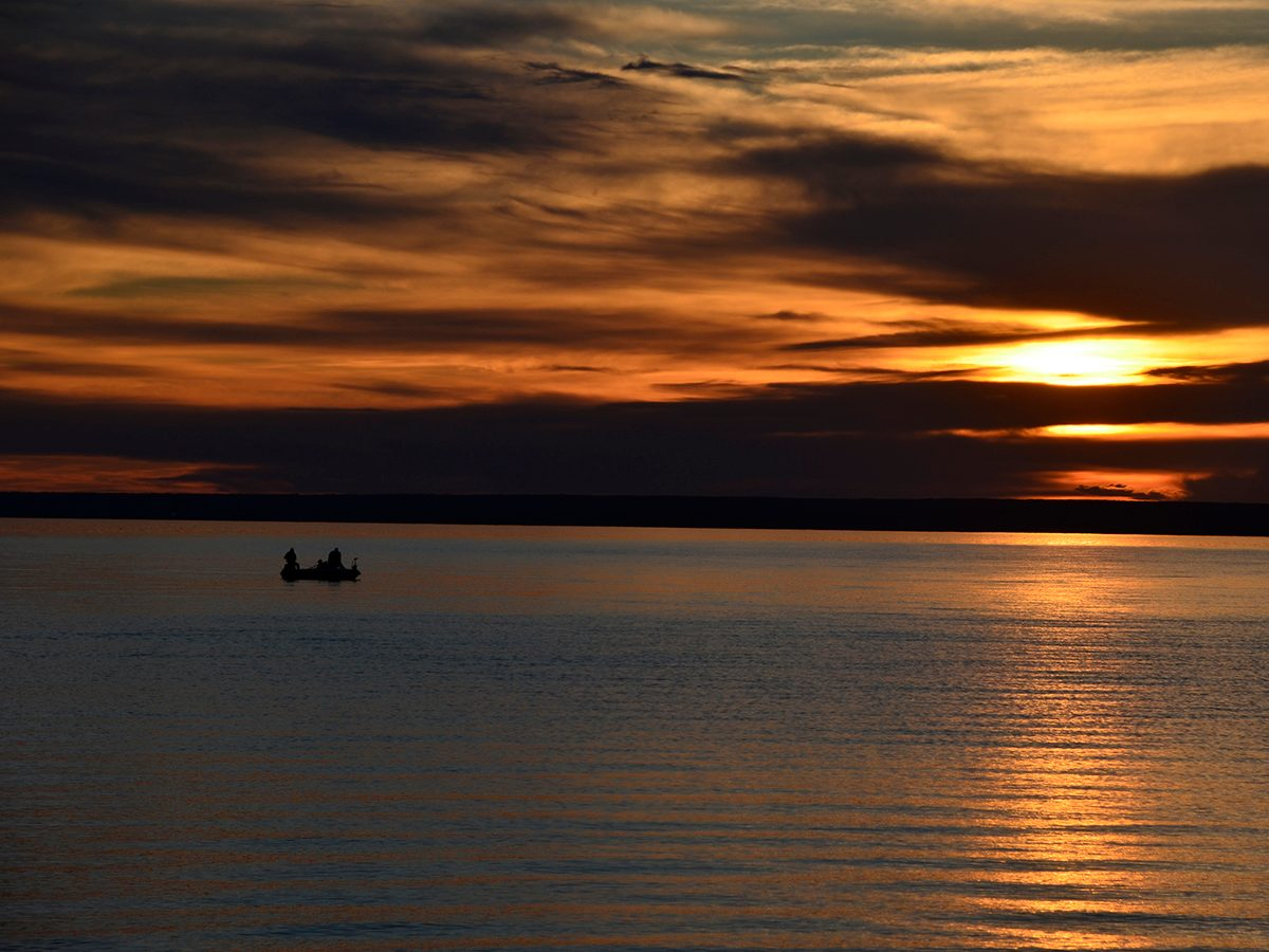 Best boat photography across Canada - Boat out at sunset