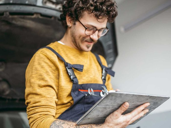 Car Maintenance Schedule to Follow for Good Car Health - Man sitting on car