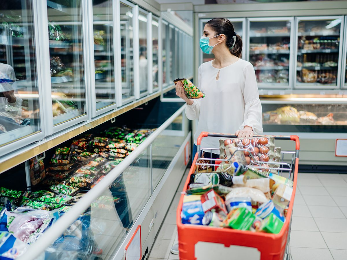 How to prep for COVID-19 this winter - woman at grocery store