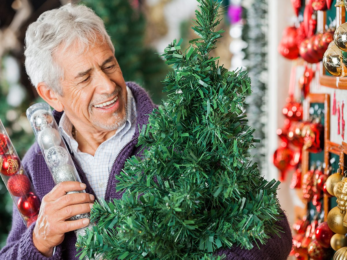 Most likely winter shortages due to COVID-19 - man buying artificial tree