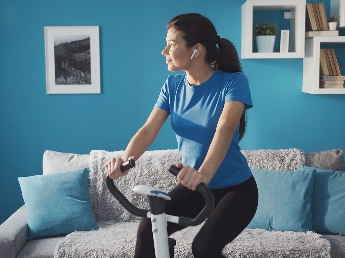 Most likely winter shortages due to COVID-19 - woman on stationary bike at home
