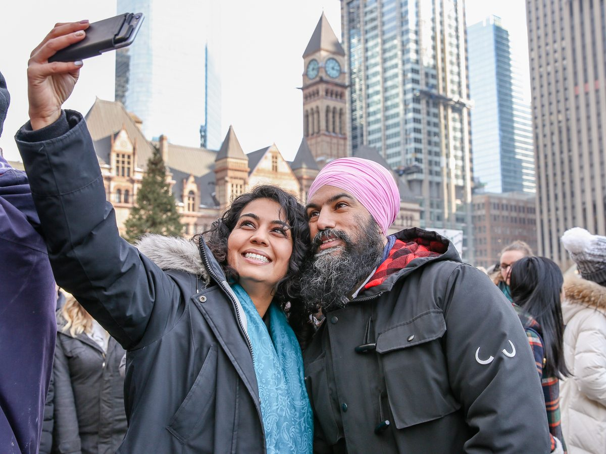 NDP Party leader Jagmeet Singh taking a selfie with a fan