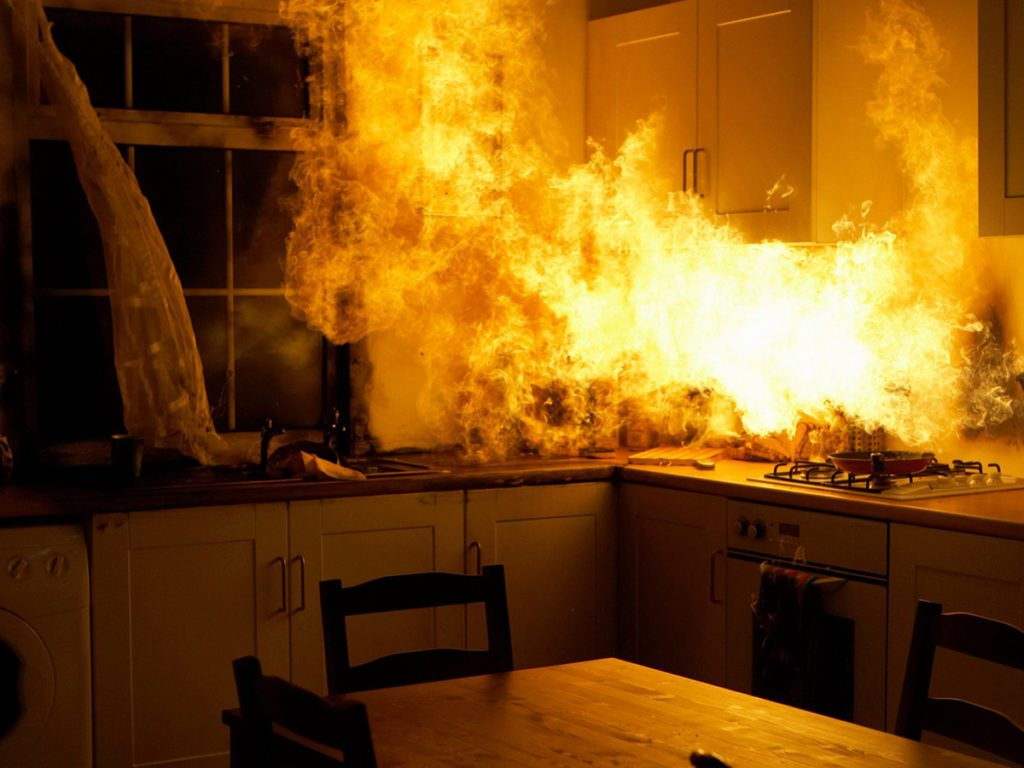 Home fire hazards - Fire raging in domestic kitchen at night