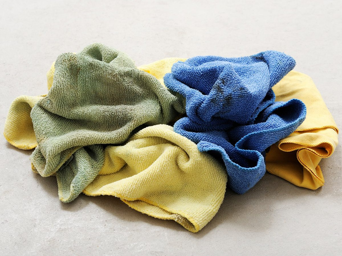 Home fire hazards - Pile of dirty cotton towels or rags on a concrete floor
