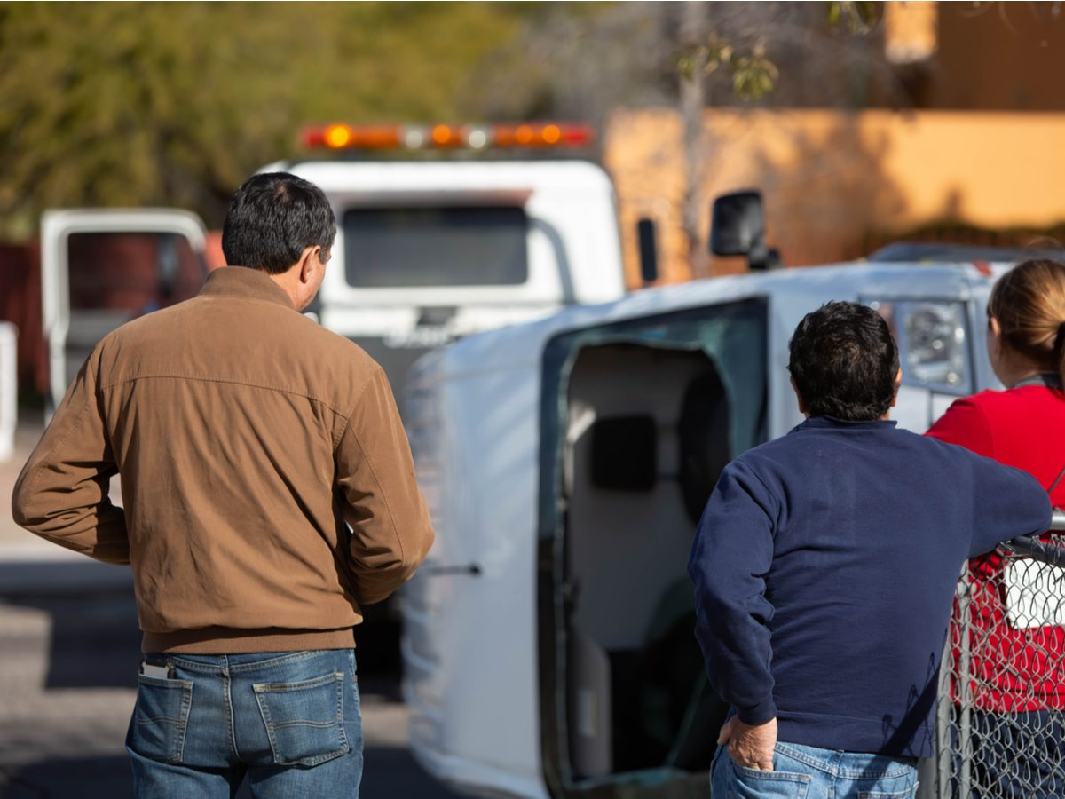 Bystanders watching aftermath of car crash
