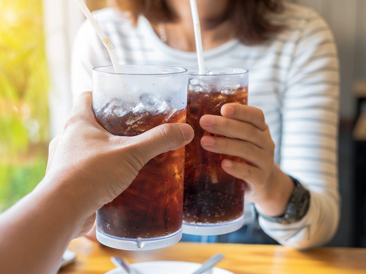 Health news - drinking cola at restaurant