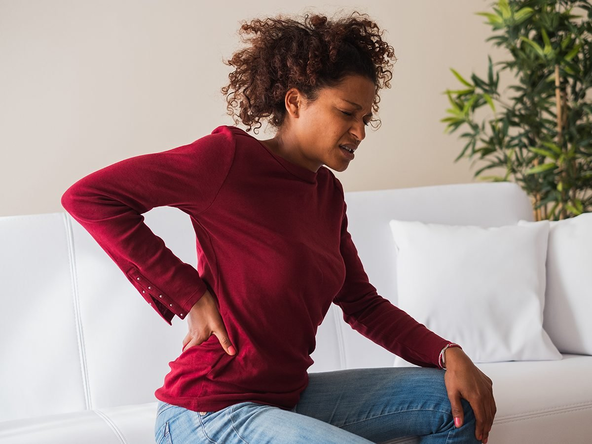 Health news - young woman suffering chronic back pain