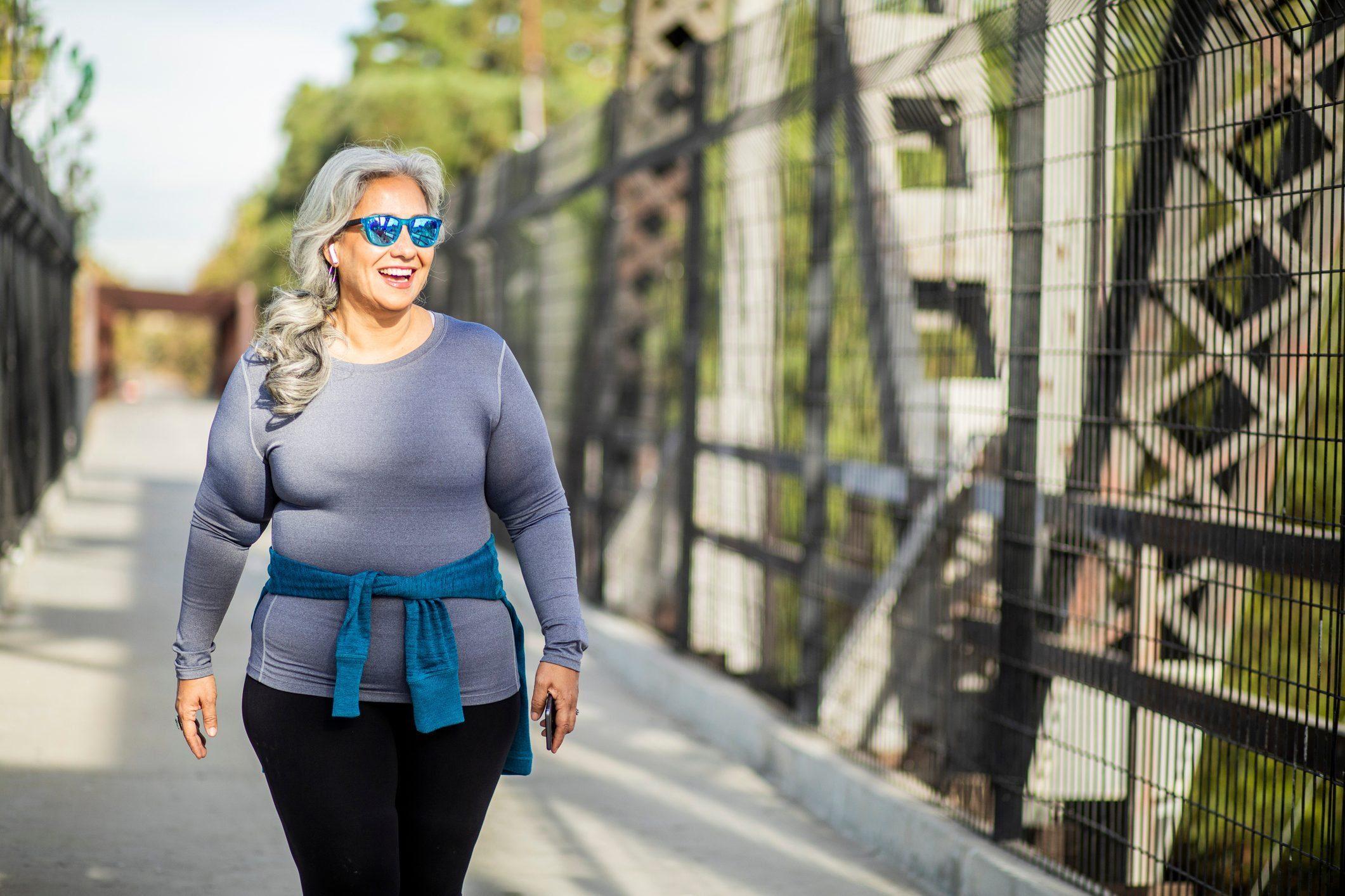 Healthy Booze Alternatives - Woman walking across bridge