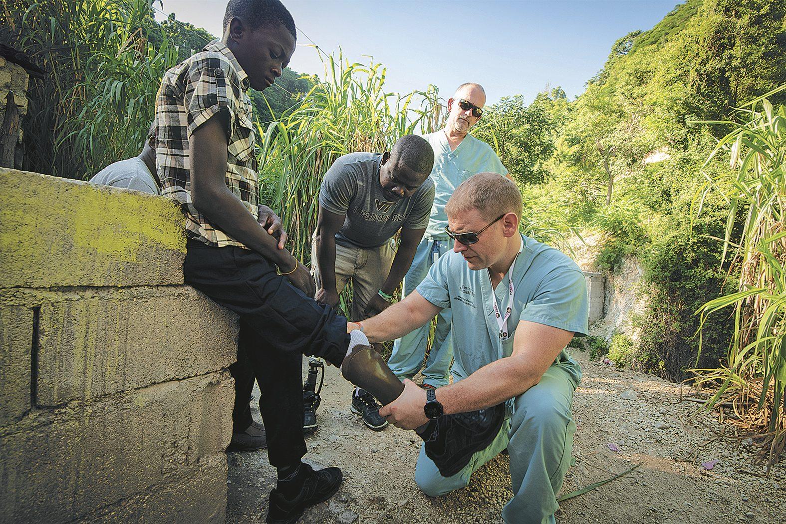 Dr. Andrew Furey examining a patient in Haiti