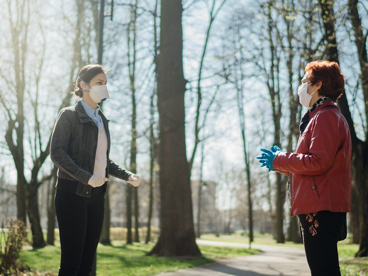 Why some people are more likely to spread COVID-19 - people talking in park