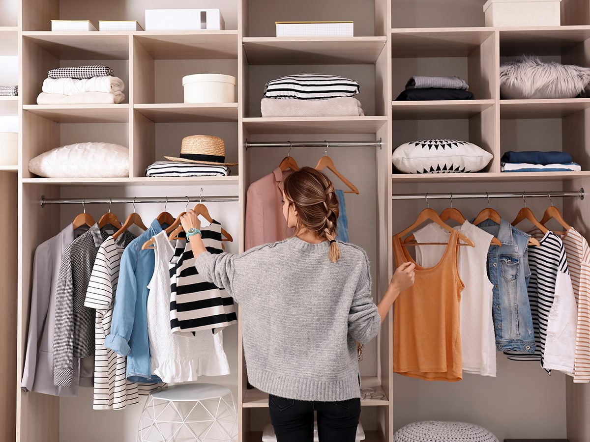 Best chore based on zodiac sign - woman organizing closet