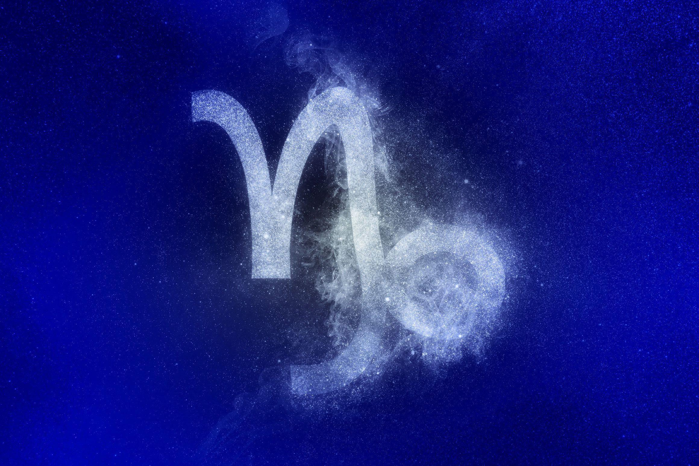 capricorn zodiac symbol in winter colors