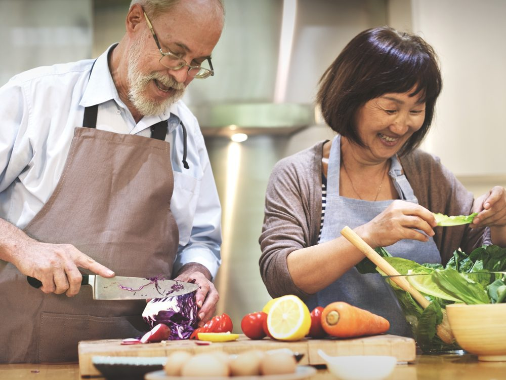 Home to Heart Meals - Couple cooking together