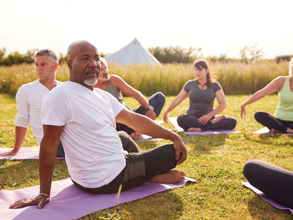 Ways to Make Life Better for Your Aging Parent - Seniors doing yoga
