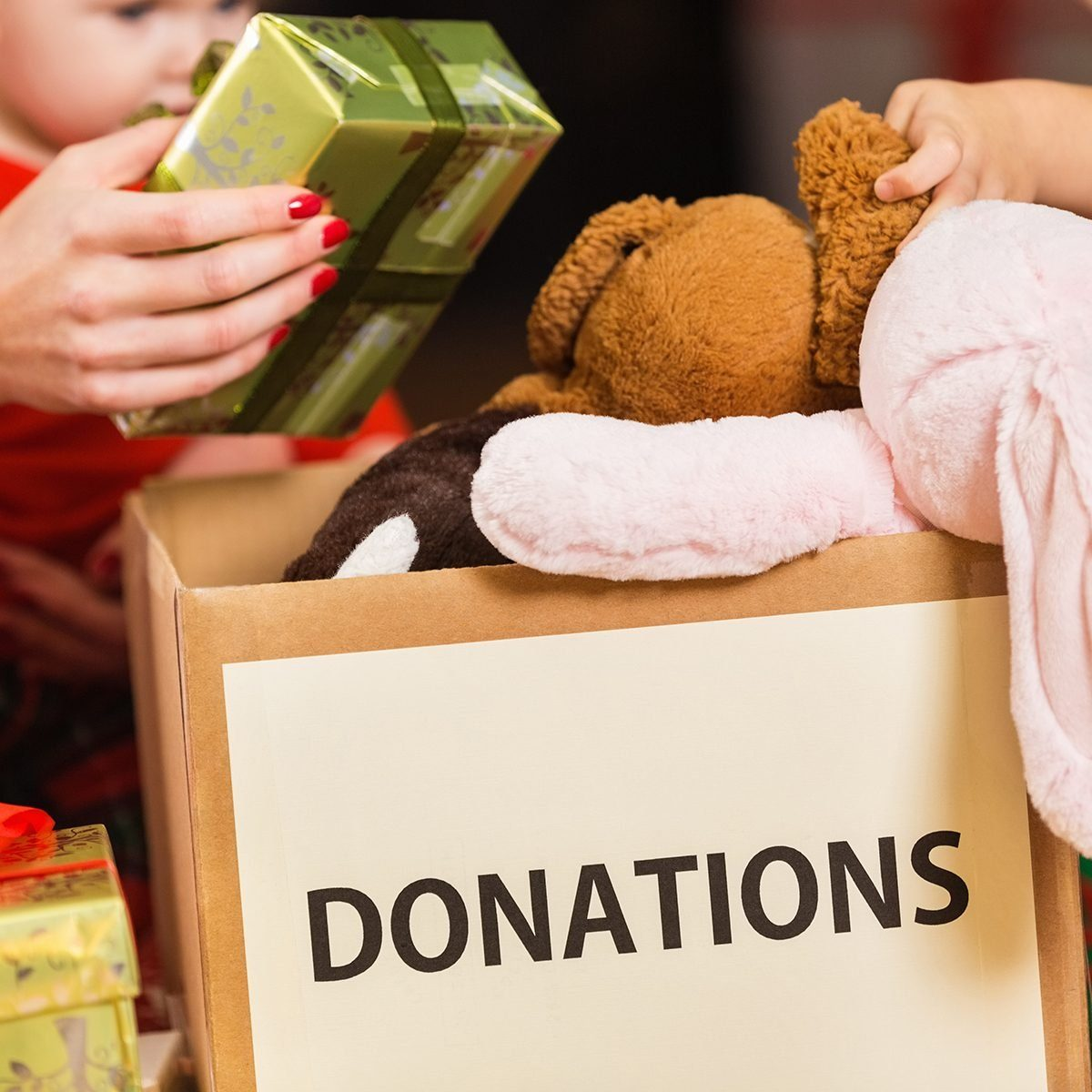 Family donating gifts and toys to charity for Christmas holiday