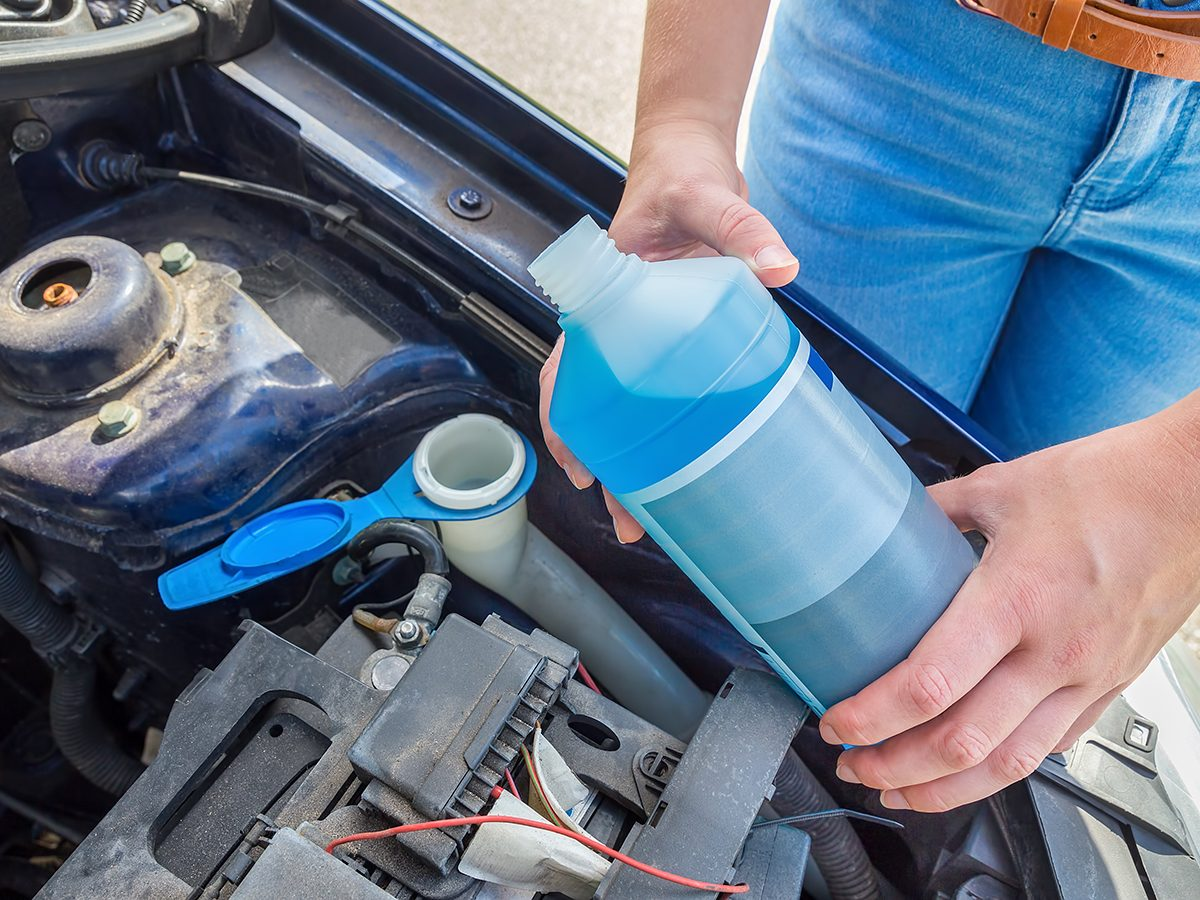 How to change windshield wiper fluid - Pouring fluid in