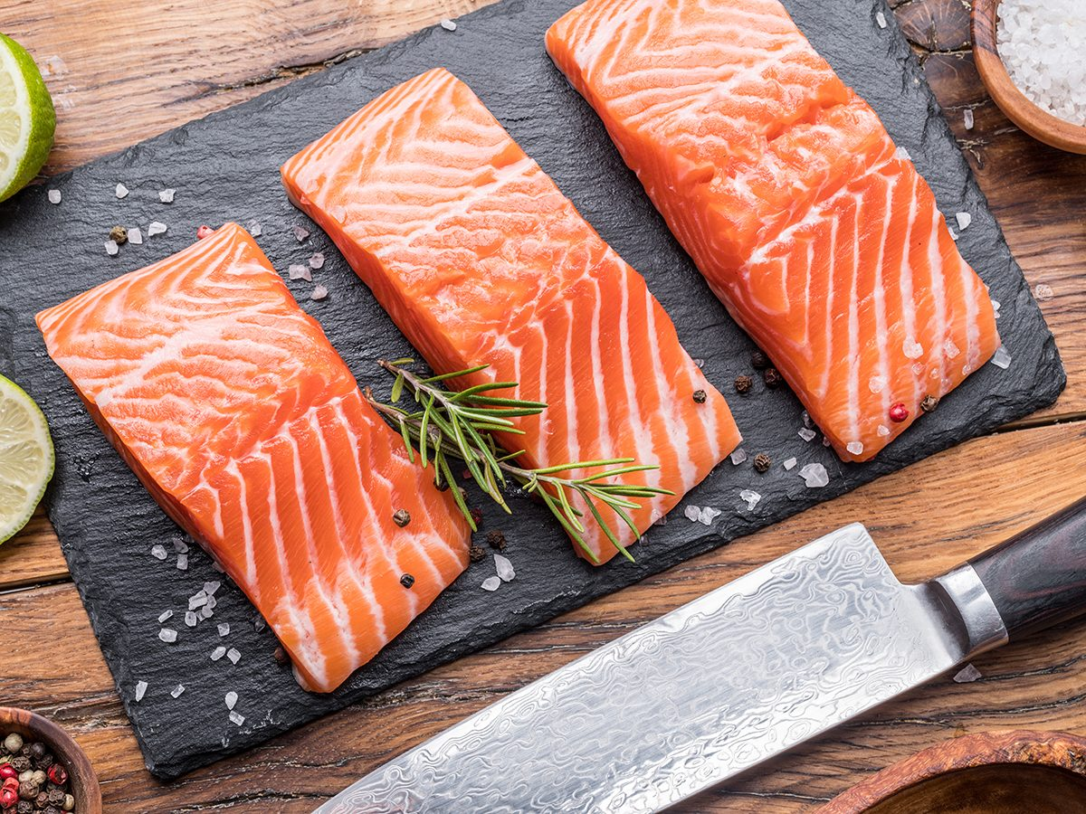 How to get fish smell out of your kitchen - Salmon filets on cutting board