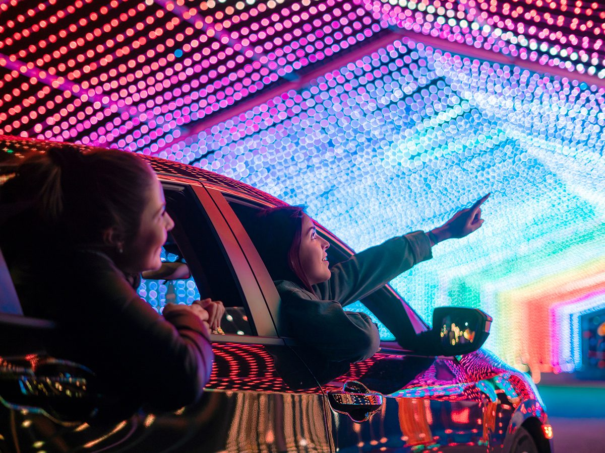 Drive-through Christmas lights - People in car driving through light tunnel