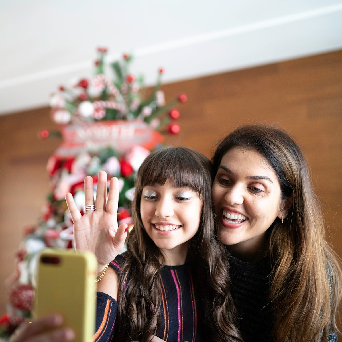 Mother and daughter making a video conference at christmas time