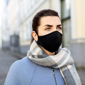 New face mask recommendations - Woman wearing disposable face mask