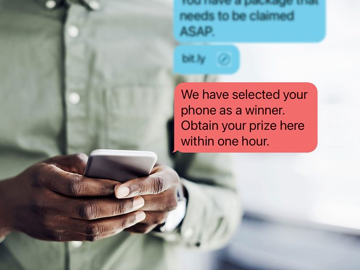 Man scrolling on iPhone with screen displaying fake, scam text messages