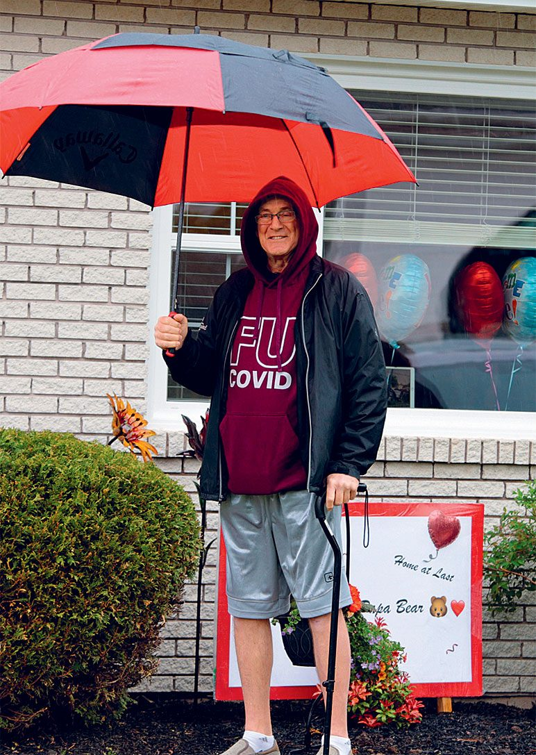Rick Cameron standing with an umbrella.