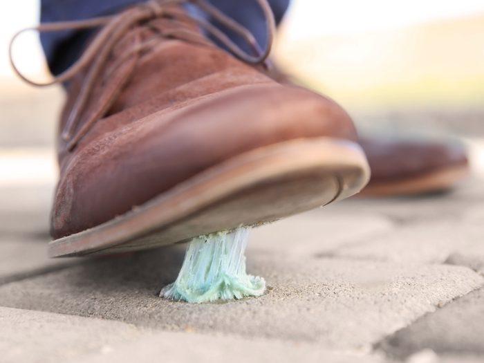 Stepping on gum on sidewalk