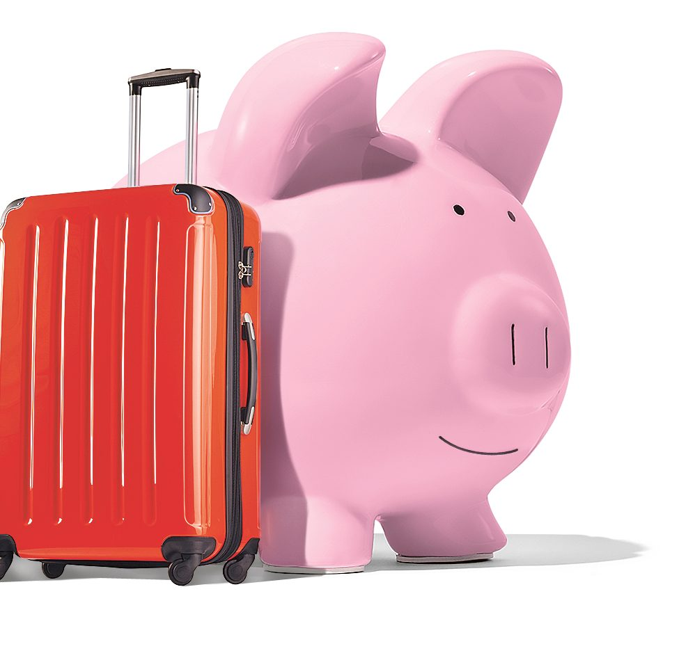 Piggy bank with carry-on luggage