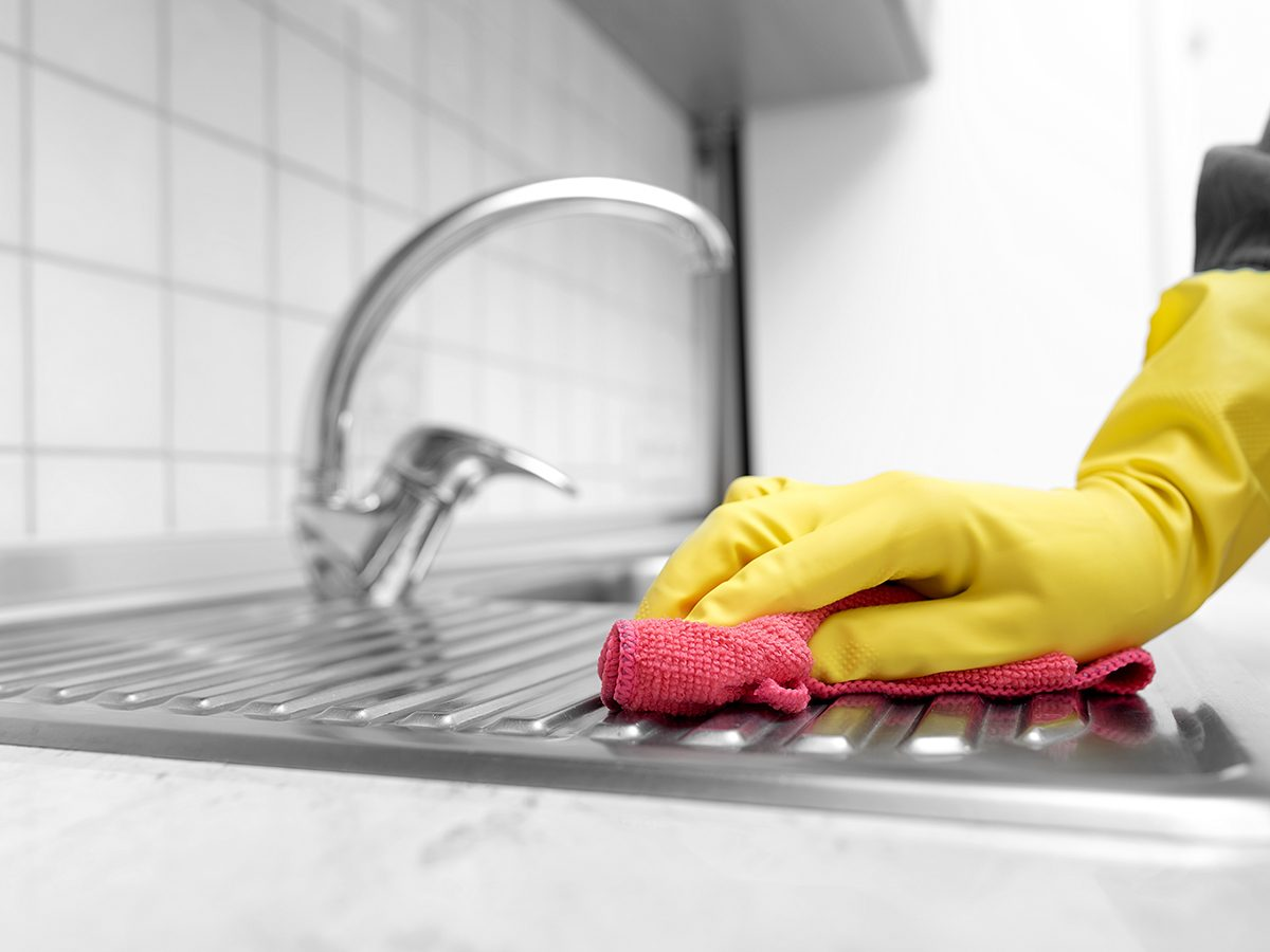 Never use a Magic Eraser to clean these things - Person cleaning sink