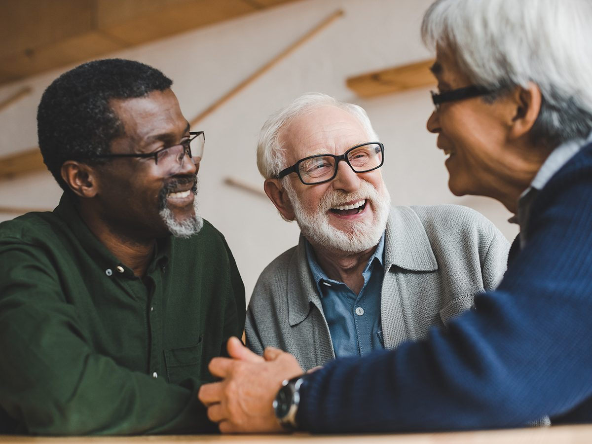 Aries Trust - Group of senior friends spending time together and laughing